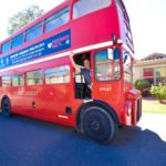 Realtor Rob Olson and his double-decker English bus in Laveen, AZ.