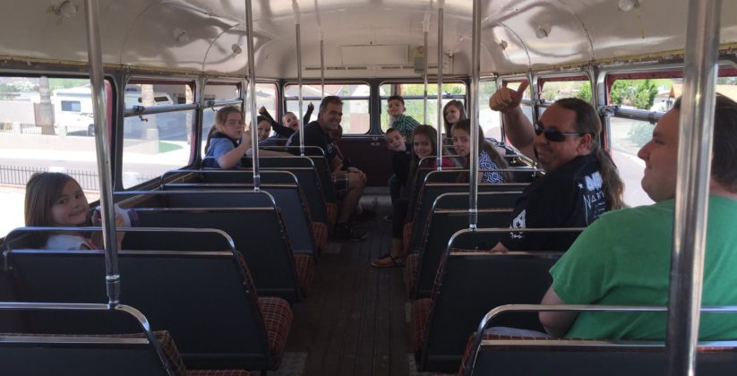 Rob Olson's Red Bus is the party ride for these children.