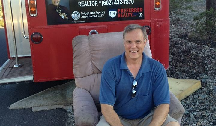 Realtor Rob Olson takes a seat in the Laveen Chair!